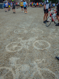 It started to rain again while at Aid Station 1.  As people picked up their bikes to continue on, it left an outline of each bike.